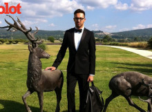 November Style Master Stephan Rabimov, wearing a Sandro tuxedo, Cole Haan shoes, Longchamp tote and Yohji Yamamoto glasses, at the Pierre Cardin chateau in Lacoste, France.